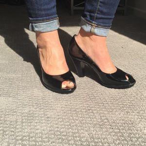 Black open toe paten leather heel.